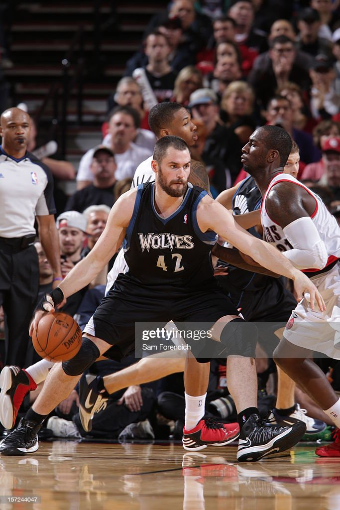 <a gi-track='captionPersonalityLinkClicked' href=/galleries/search?phrase=Kevin+Love&family=editorial&specificpeople=4212726 ng-click='$event.stopPropagation()'>Kevin Love</a> #42 of the Minnesota Timberwolves drives to the basket against <a gi-track='captionPersonalityLinkClicked' href=/galleries/search?phrase=J.J.+Hickson&family=editorial&specificpeople=4226173 ng-click='$event.stopPropagation()'>J.J. Hickson</a> #21 of the Portland Trail Blazers on November 23, 2012 at the Rose Garden Arena in Portland, Oregon.