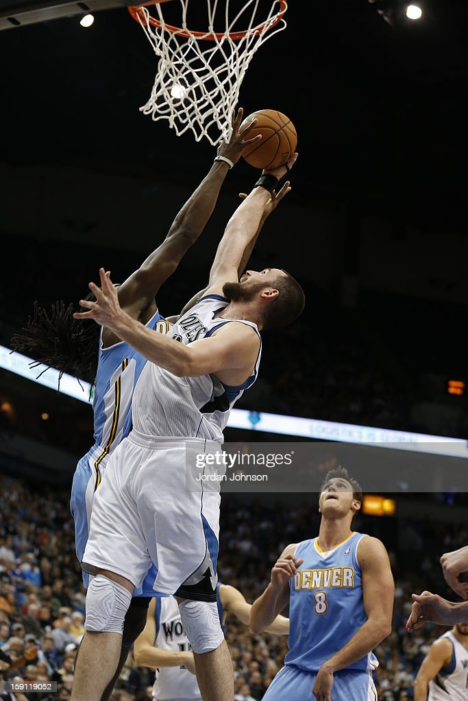 <a gi-track='captionPersonalityLinkClicked' href=/galleries/search?phrase=Kevin+Love&family=editorial&specificpeople=4212726 ng-click='$event.stopPropagation()'>Kevin Love</a> #42 of the Minnesota Timberwolves drives to the basket against the Denver Nuggets on November 21, 2012 at Target Center in Minneapolis, Minnesota.