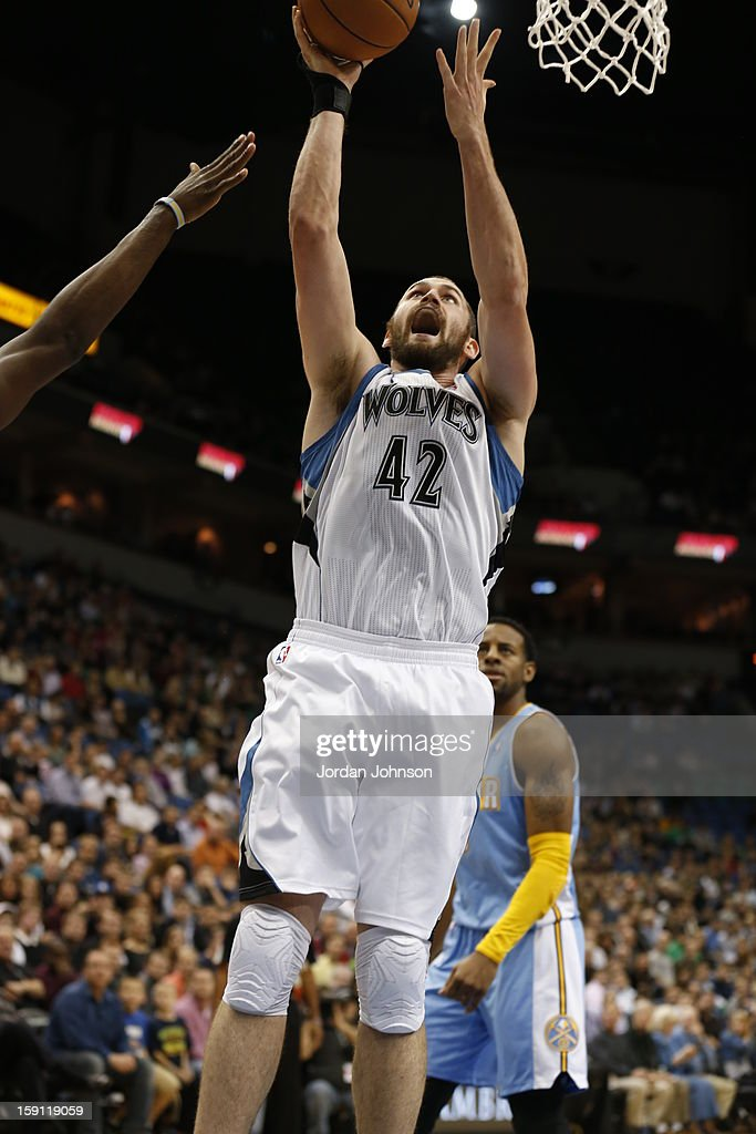 Kevin Love #42 of the Minnesota Timberwolves drives to the basket against the Denver Nuggets on November 21, 2012 at Target Center in Minneapolis, Minnesota.