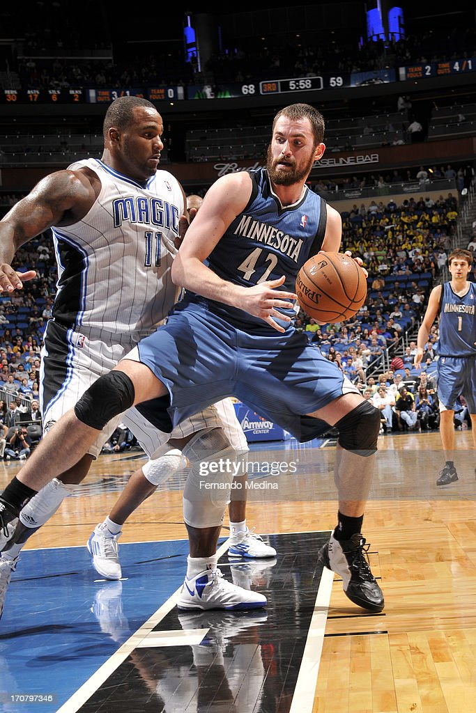 <a gi-track='captionPersonalityLinkClicked' href=/galleries/search?phrase=Kevin+Love&family=editorial&specificpeople=4212726 ng-click='$event.stopPropagation()'>Kevin Love</a> #42 of the Minnesota Timberwolves drives to the basket against <a gi-track='captionPersonalityLinkClicked' href=/galleries/search?phrase=Glen+Davis+-+Basketball+Player&family=editorial&specificpeople=709385 ng-click='$event.stopPropagation()'>Glen Davis</a> #11 of the Orlando Magic on December 17, 2012 at Amway Center in Orlando, Florida.