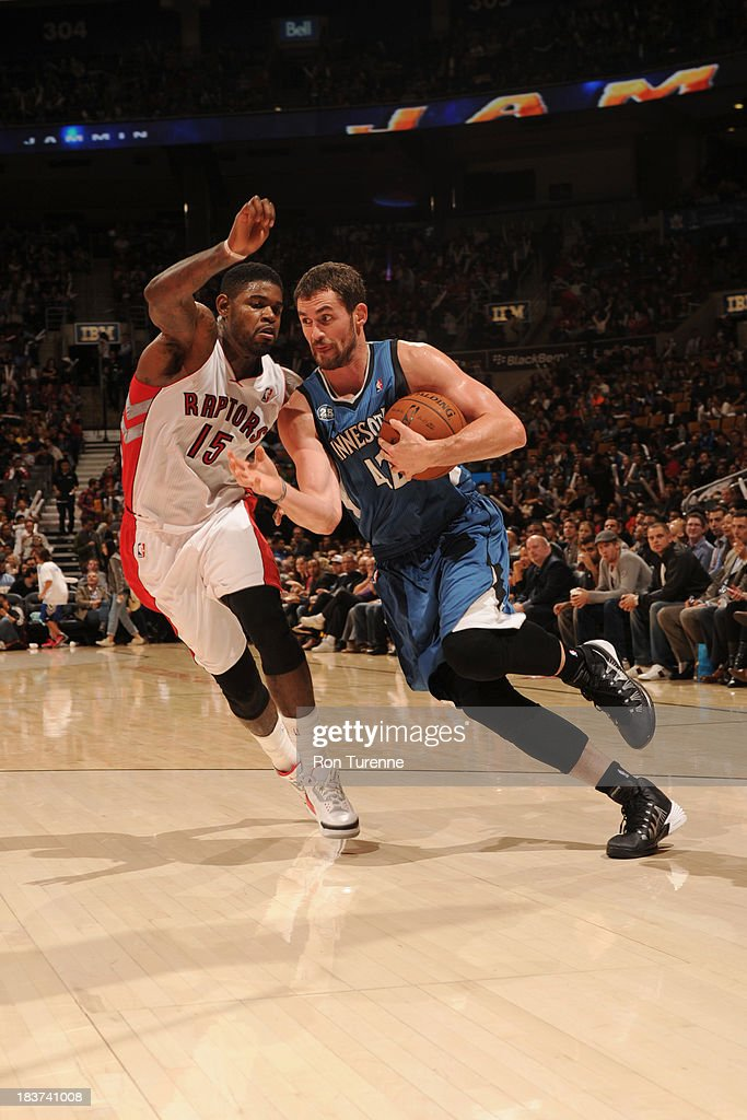 <a gi-track='captionPersonalityLinkClicked' href=/galleries/search?phrase=Kevin+Love&family=editorial&specificpeople=4212726 ng-click='$event.stopPropagation()'>Kevin Love</a> #42 of the Minnesota Timberwolves drives to the basket against <a gi-track='captionPersonalityLinkClicked' href=/galleries/search?phrase=Amir+Johnson&family=editorial&specificpeople=556786 ng-click='$event.stopPropagation()'>Amir Johnson</a> #15 of the Toronto Raptors during the game on October 9, 2013 at the Air Canada Centre in Toronto, Ontario, Canada.
