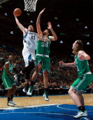 Kevin Love of the Minnesota Timberwolves drives to the basket against Vitor Faverani of the Boston Celtics during the NBA preseason game at the Bell...