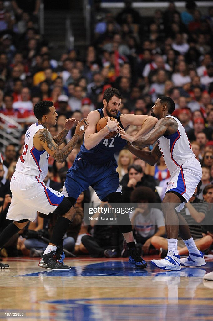 <a gi-track='captionPersonalityLinkClicked' href=/galleries/search?phrase=Kevin+Love&family=editorial&specificpeople=4212726 ng-click='$event.stopPropagation()'>Kevin Love</a> #42 of the Minnesota Timberwolves drives to the basket against <a gi-track='captionPersonalityLinkClicked' href=/galleries/search?phrase=Matt+Barnes+-+Basketball+Player&family=editorial&specificpeople=202880 ng-click='$event.stopPropagation()'>Matt Barnes</a> #22 and <a gi-track='captionPersonalityLinkClicked' href=/galleries/search?phrase=DeAndre+Jordan&family=editorial&specificpeople=4665718 ng-click='$event.stopPropagation()'>DeAndre Jordan</a> #6 of the Los Angeles Clippers at Staples Center on November 11, 2013 in Los Angeles, California.