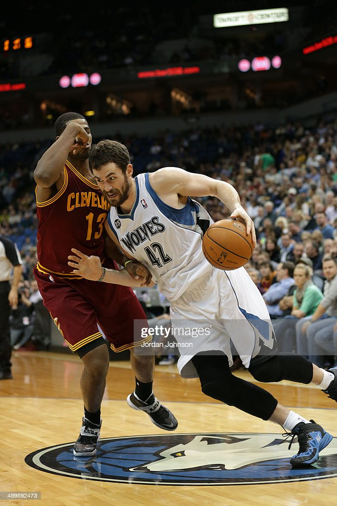 Kevin Love #42 of the Minnesota Timberwolves drives to the basket against the Cleveland Cavaliers on November 13, 2013 at Target Center in Minneapolis, Minnesota.