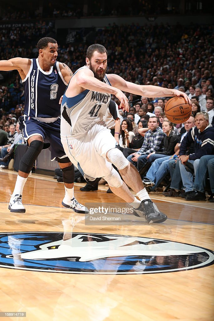 <a gi-track='captionPersonalityLinkClicked' href=/galleries/search?phrase=Kevin+Love&family=editorial&specificpeople=4212726 ng-click='$event.stopPropagation()'>Kevin Love</a> #42 of the Minnesota Timberwolves drives to the basket around <a gi-track='captionPersonalityLinkClicked' href=/galleries/search?phrase=Thabo+Sefolosha&family=editorial&specificpeople=587449 ng-click='$event.stopPropagation()'>Thabo Sefolosha</a> #2 of the Oklahoma City Thunder on December 20, 2012 at Target Center in Minneapolis, Minnesota.