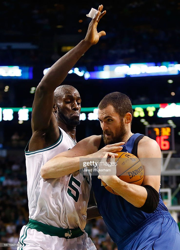 Kevin Love #42 of the Minnesota Timberwolves drives to the basket in front of Kevin Garnett #5 of the Boston Celtics during the game on December 5, 2012 at TD Garden in Boston, Massachusetts.
