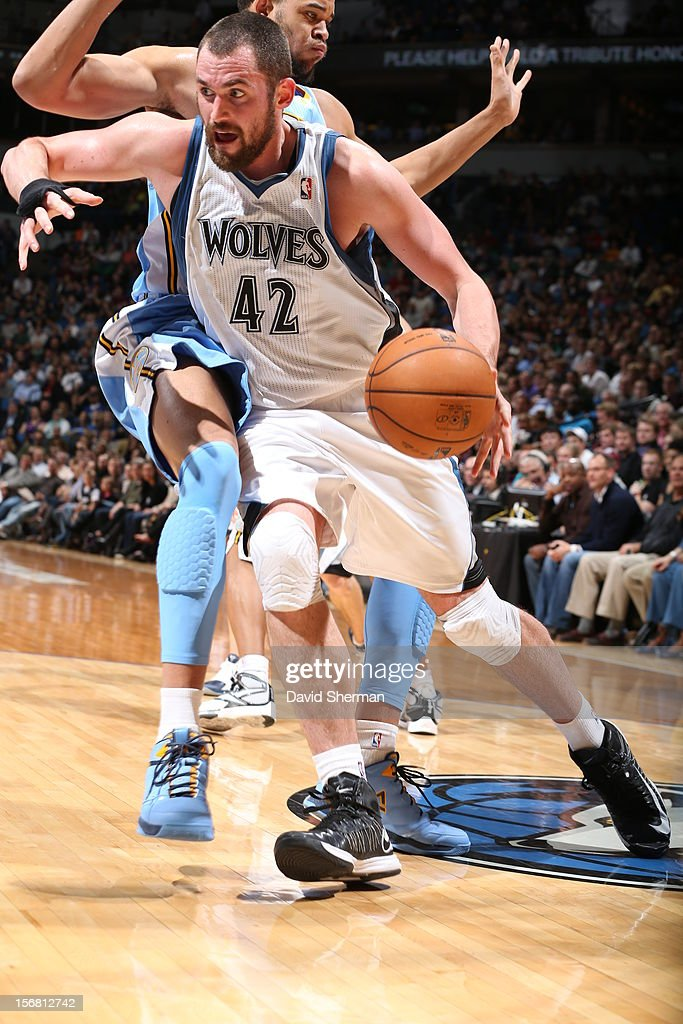 Kevin Love #42 of the Minnesota Timberwolves drives under pressure during the game between the Minnesota Timberwolves and the Denver Nuggets on November 21, 2012 at Target Center in Minneapolis, Minnesota.