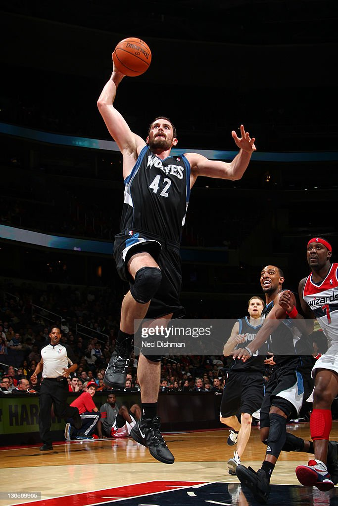 <a gi-track='captionPersonalityLinkClicked' href=/galleries/search?phrase=Kevin+Love&family=editorial&specificpeople=4212726 ng-click='$event.stopPropagation()'>Kevin Love</a> #42 of the Minnesota Timberwolves dunks against the Washington Wizards during the game at the Verizon Center on January 8, 2012 in Washington, DC.