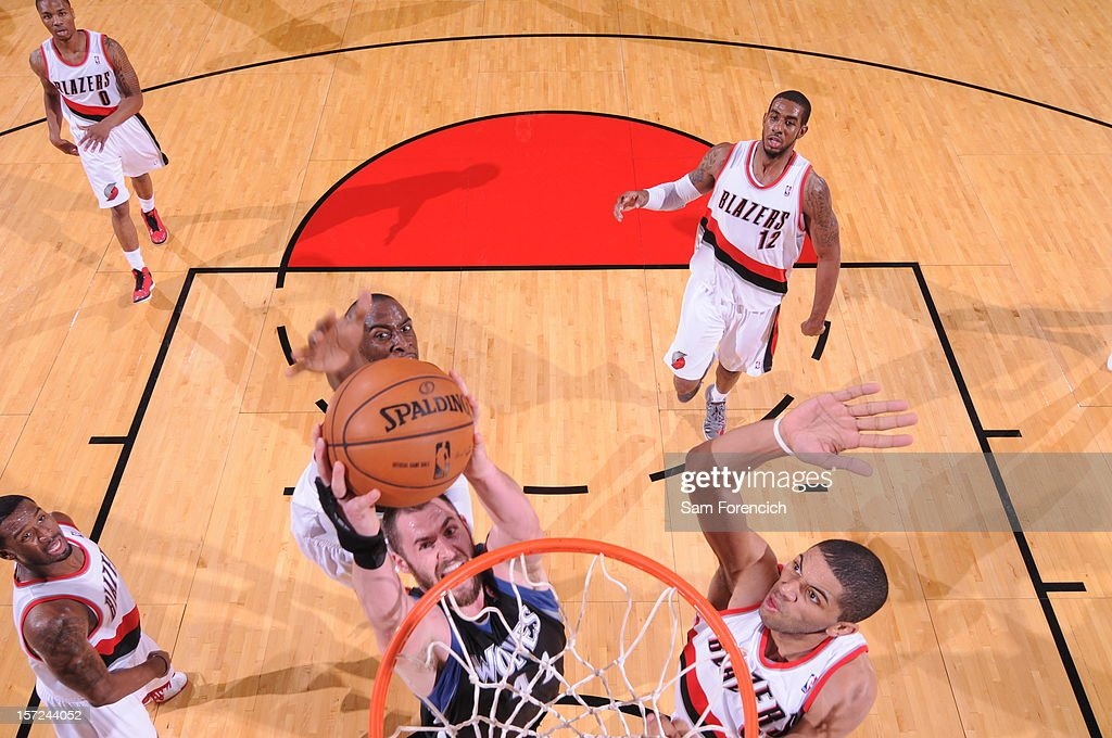 <a gi-track='captionPersonalityLinkClicked' href=/galleries/search?phrase=Kevin+Love&family=editorial&specificpeople=4212726 ng-click='$event.stopPropagation()'>Kevin Love</a> #42 of the Minnesota Timberwolves dunks the ball against <a gi-track='captionPersonalityLinkClicked' href=/galleries/search?phrase=Nicolas+Batum&family=editorial&specificpeople=3746275 ng-click='$event.stopPropagation()'>Nicolas Batum</a> #88 of the Portland Trail Blazers on November 23, 2012 at the Rose Garden Arena in Portland, Oregon.