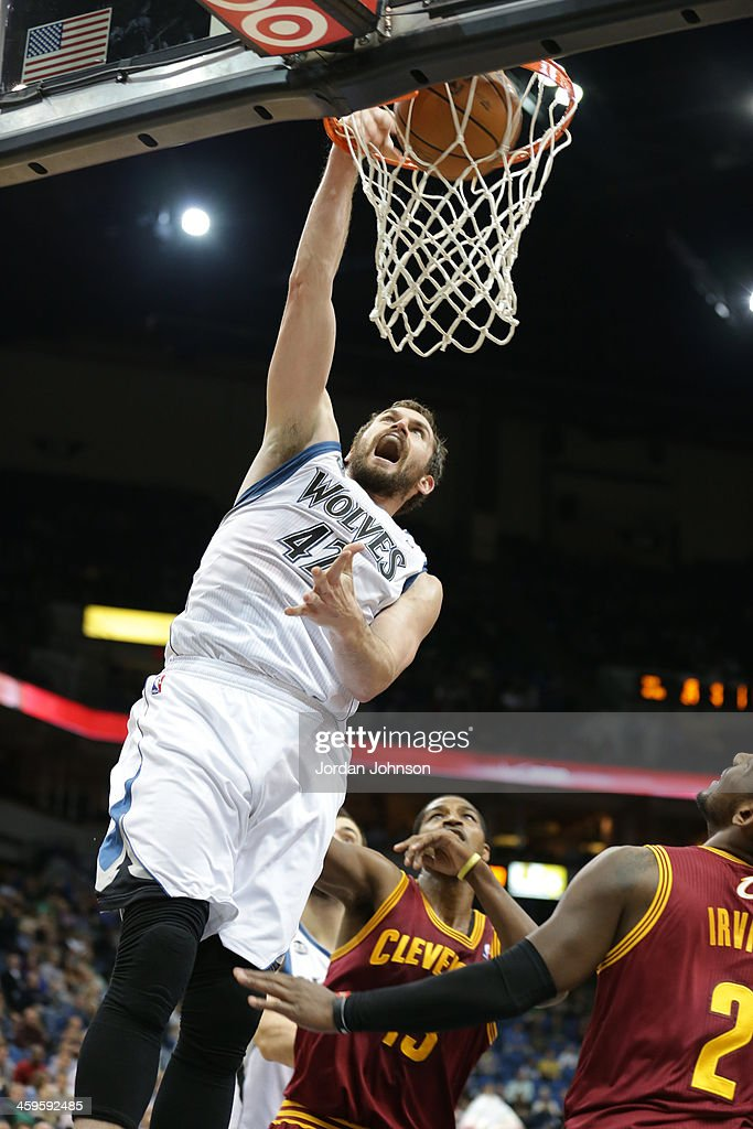 Kevin Love #42 of the Minnesota Timberwolves dunks the ball against the Cleveland Cavaliers on November 13, 2013 at Target Center in Minneapolis, Minnesota.
