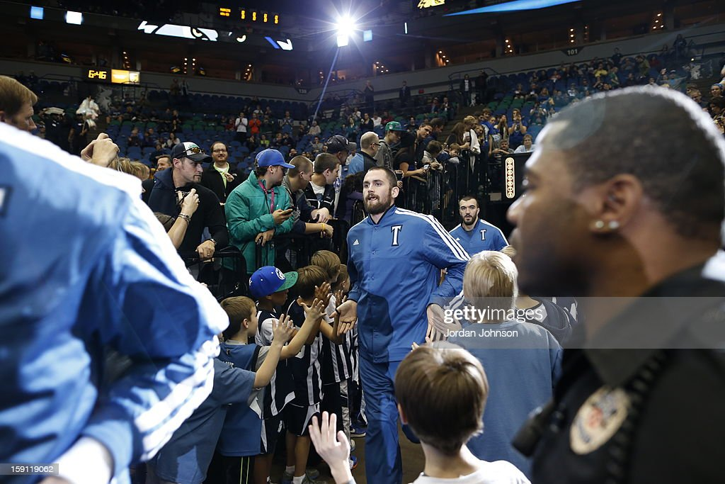 <a gi-track='captionPersonalityLinkClicked' href=/galleries/search?phrase=Kevin+Love&family=editorial&specificpeople=4212726 ng-click='$event.stopPropagation()'>Kevin Love</a> #42 of the Minnesota Timberwolves enters the court before the game against the Denver Nuggets on November 21, 2012 at Target Center in Minneapolis, Minnesota.