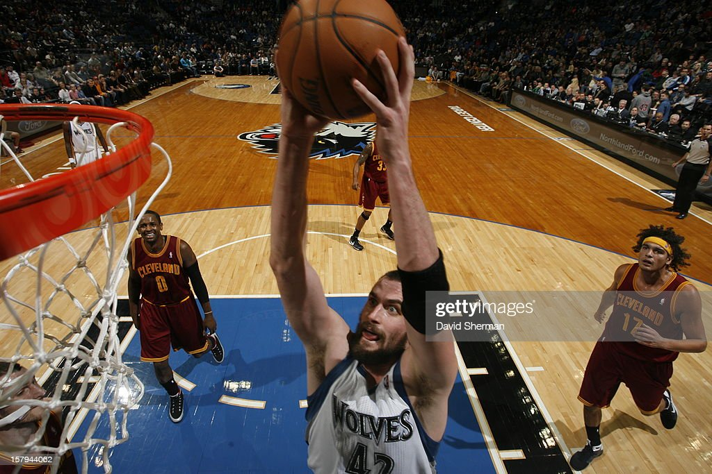 Kevin Love #42 of the Minnesota Timberwolves goes in for the dunk against the Cleveland Cavaliers during the game on December 7, 2012 at Target Center in Minneapolis, Minnesota.