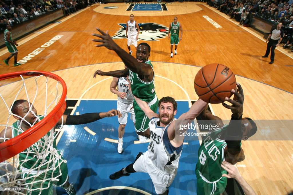 Kevin Love #42 of the Minnesota Timberwolves goes up for a rebound against the Boston Celtics on November 16, 2013 at Target Center in Minneapolis, Minnesota.