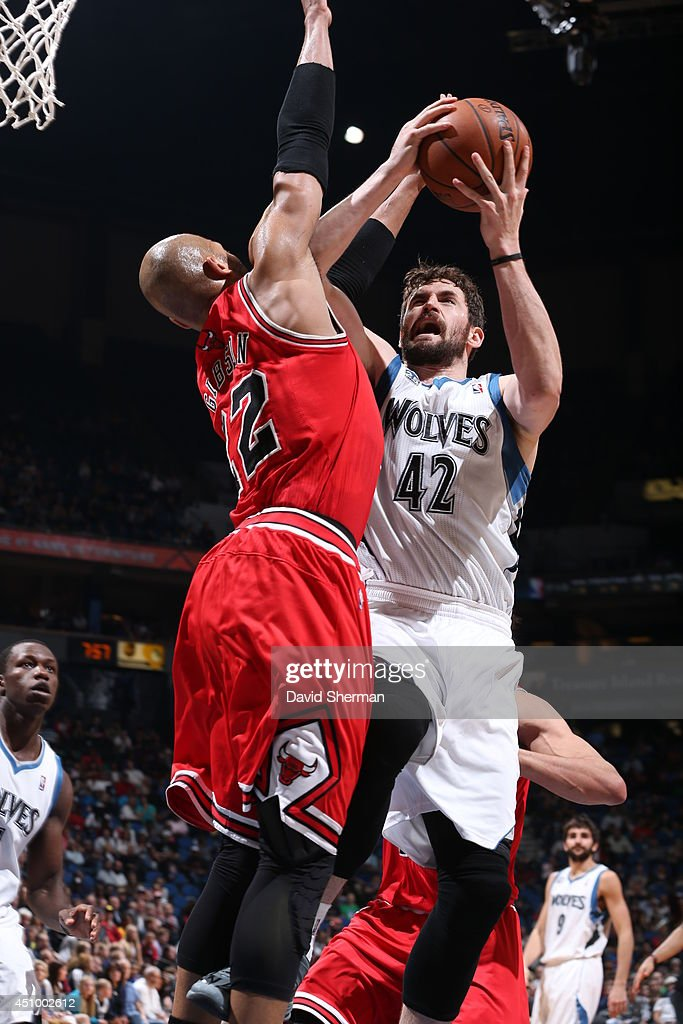 Kevin Love #42 of the Minnesota Timberwolves goes up for a shot against the Chicago Bulls during the game on April 9, 2014 at Target Center in Minneapolis, Minnesota.