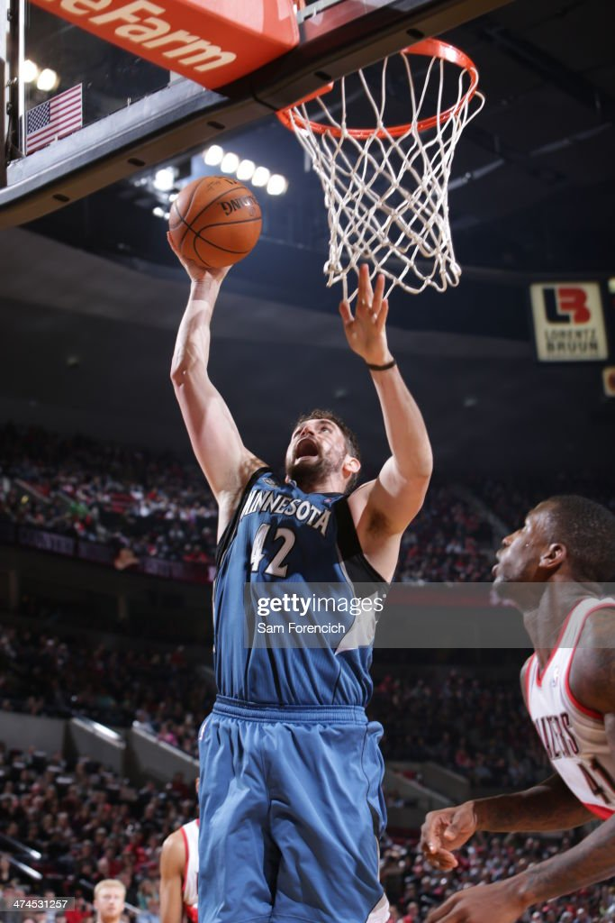 Kevin Love #42 of the Minnesota Timberwolves goes up for a shot during a game against the Portland Trail Blazers on February 23, 2014 at the Moda Center Arena in Portland, Oregon.