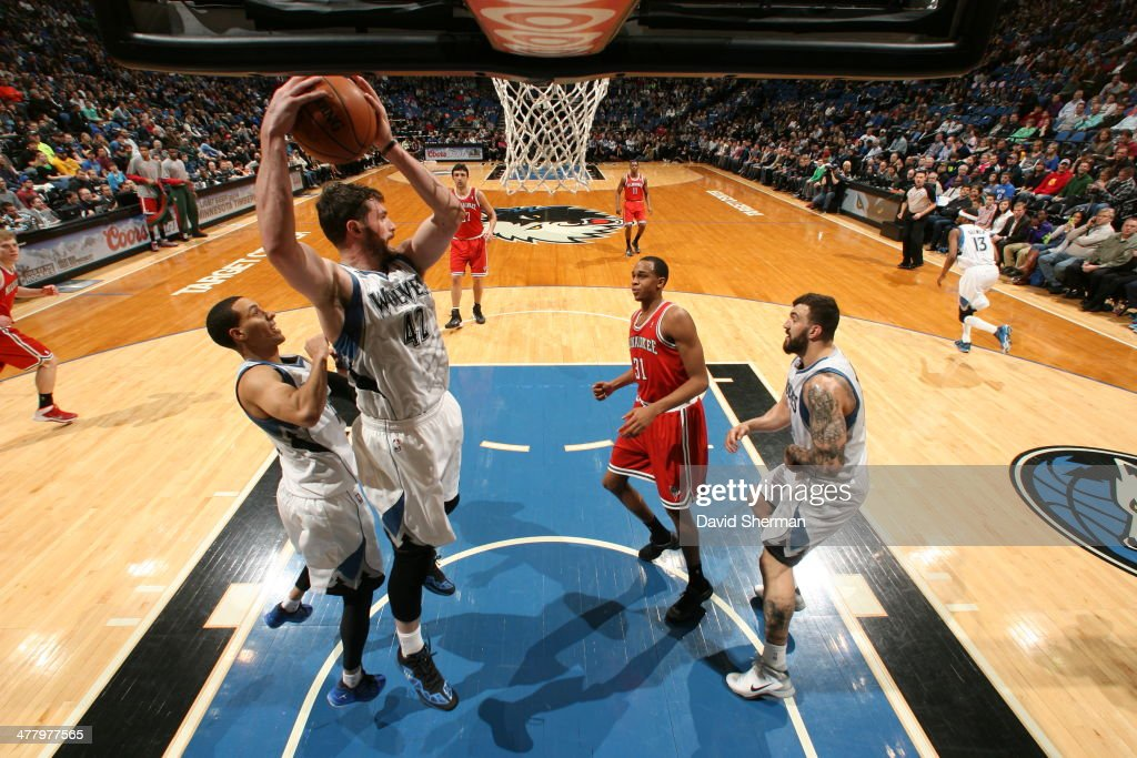 Kevin Love #42 of the Minnesota Timberwolves grabs a rebound against the Milwaukee Bucks on March 11, 2014 at Target Center in Minneapolis, Minnesota.