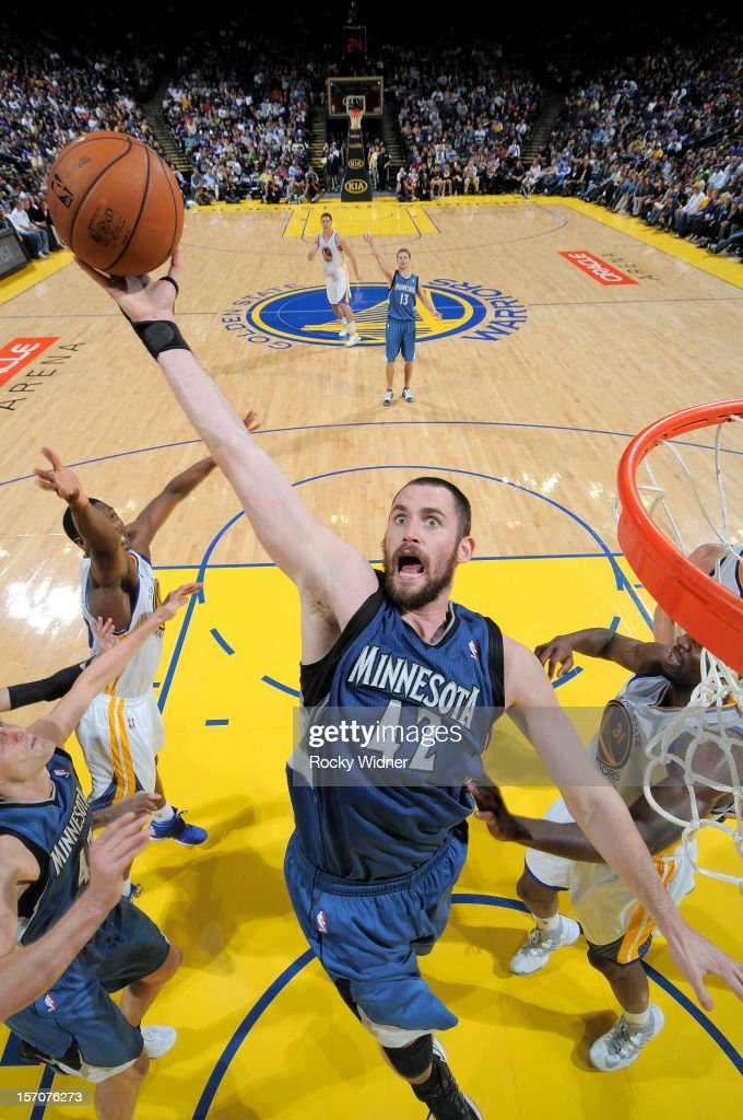 Kevin Love #42 of the Minnesota Timberwolves grabs the rebound in a game against the Golden State Warriors on November 24, 2012 at Oracle Arena in Oakland, California.