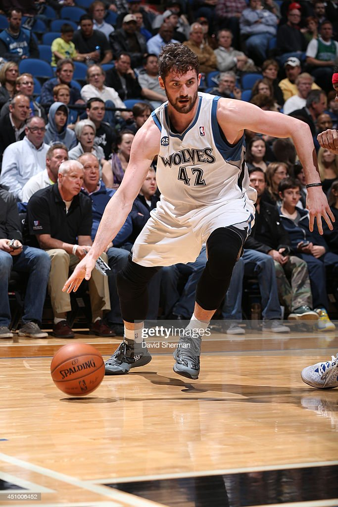 Kevin Love #42 of the Minnesota Timberwolves handles the ball against the Los Angeles Clippers on March 31, 2014 at Target Center in Minneapolis, Minnesota.