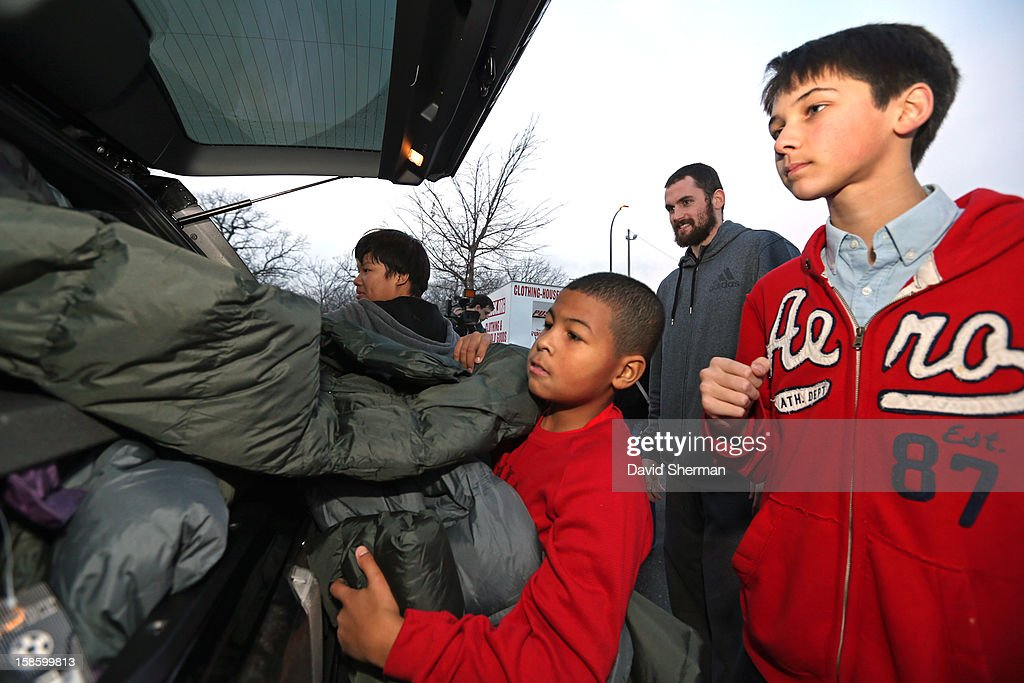 Kevin Love #42 of the Minnesota Timberwolves has help unloading coats collected by the fifth annual Kevin Love's Coat Drive to help those in need during the Holiday Season on December 19, 2012 at the Minneapolis Salvation Army Central Worship and Community Center in Minneapolis, Minnesota.