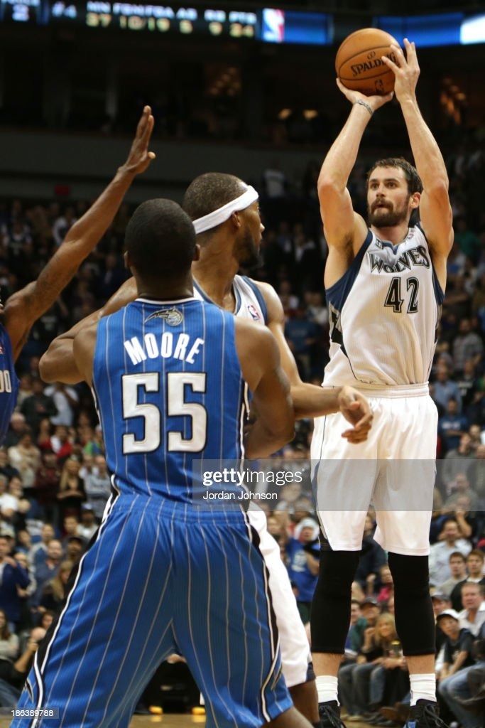 Kevin Love #42 of the Minnesota Timberwolves hits the game winning shot against the Orlando Magic during the season and home opening game on October 30, 2013 at Target Center in Minneapolis, Minnesota.