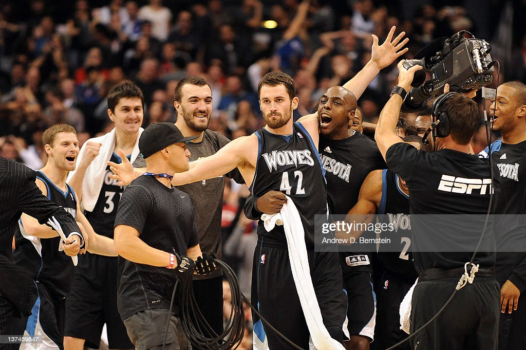 Kevin Love #42 of the Minnesota Timberwolves is congratulated by his teammates after shooting the game winning basket against the Los Angeles Clippers at Staples Center on January 20, 2012 in Los Angeles, California.