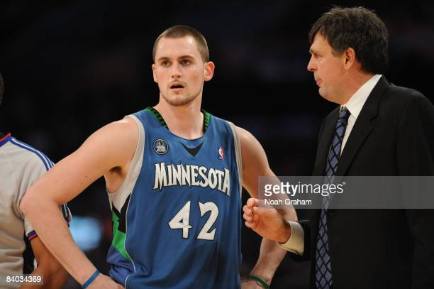 Kevin Love of the Minnesota Timberwolves is directed by Head Coach Kevin McHale during their game against the Los Angeles Lakers at Staples Center on...