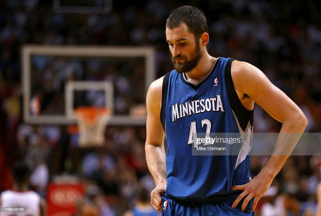 Kevin Love #42 of the Minnesota Timberwolves looks on during a game against the Miami Heat at American Airlines Arena on December 18, 2012 in Miami, Florida.