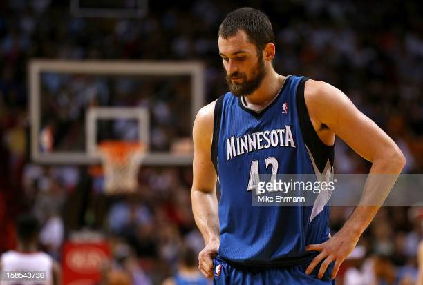 Kevin Love of the Minnesota Timberwolves looks on during a game against the Miami Heat at American Airlines Arena on December 18 2012 in Miami...