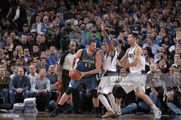 Kevin Love of the Minnesota Timberwolves looks to drive against Jason Terry and Yi Jianlian of the Dallas Mavericks on January 25 2012 at the...