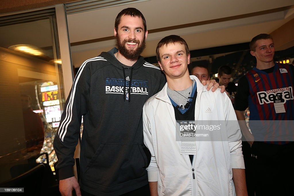 Kevin Love #42 of the Minnesota Timberwolves meets up with a fan for Make a Wish foundation during the Atlanta Hawks game on January 8, 2013 at Target Center in Minneapolis, Minnesota.