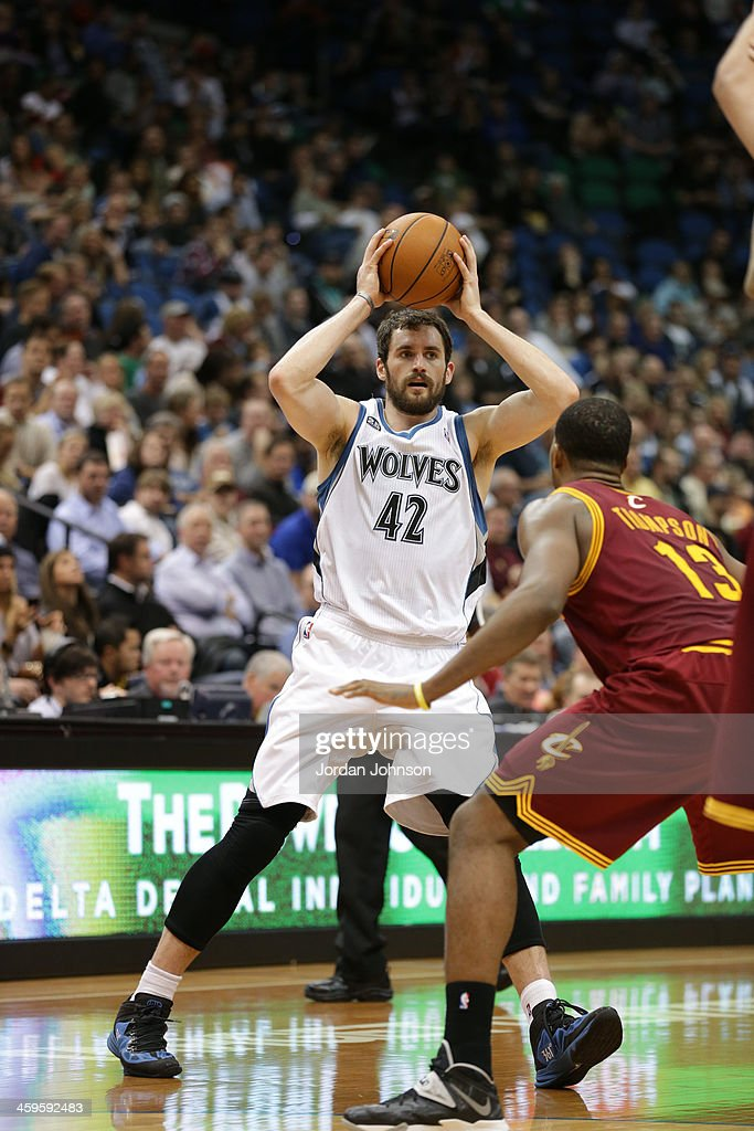 Kevin Love #42 of the Minnesota Timberwolves passes the ball against the Cleveland Cavaliers on November 13, 2013 at Target Center in Minneapolis, Minnesota.