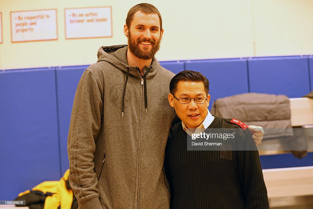 Kevin Love #42 of the Minnesota Timberwolves poses for a picture with Salvation Army Captain Vong Luangkhamdeng after delivering coats during the fifth annual Kevin Love's Coat Drive to help those in need during the Holiday Season on December 19, 2012 at the Minneapolis Salvation Army Central Worship and Community Center in Minneapolis, Minnesota.