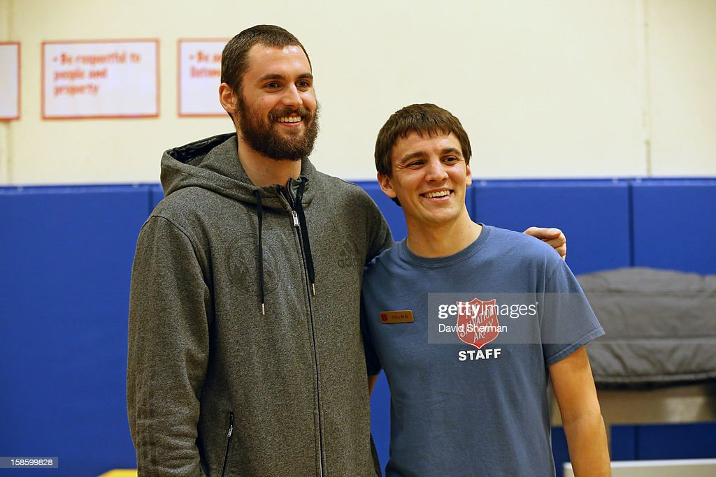 Kevin Love #42 of the Minnesota Timberwolves poses for a picture with Salvation Army After School Program Coordinator Collin Grooms after delivering coats collected during the fifth annual Kevin Love's Coat Drive to help those in need during the Holiday Season on December 19, 2012 at the Minneapolis Salvation Army Central Worship and Community Center in Minneapolis, Minnesota.