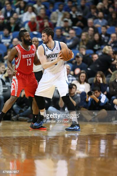 Kevin Love of the Minnesota Timberwolves posts up during the game against James Harden of the Houston Rockets on February 10 2014 at Target Center in...