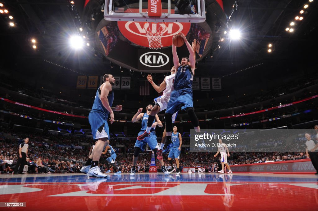 Kevin Love #42 of the Minnesota Timberwolves pulls down a rebound against the Los Angeles Clippers at Staples Center on November 11, 2013 in Los Angeles, California.