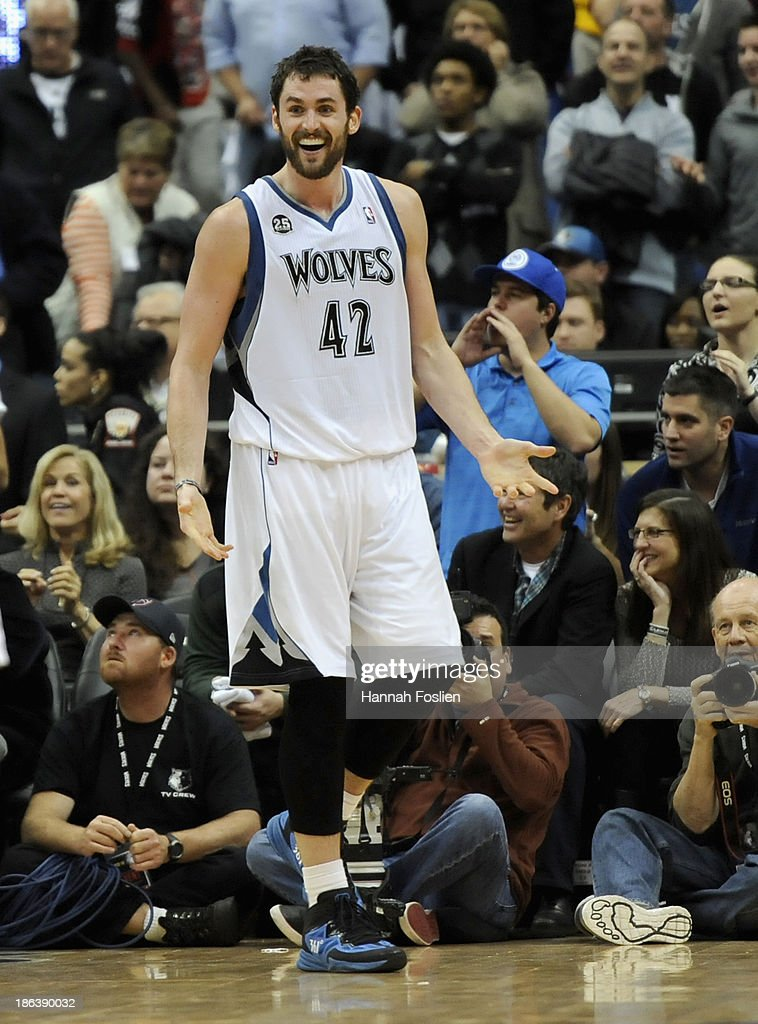 Kevin Love #42 of the Minnesota Timberwolves reacts to being called for a foul during overtime of the season opening game against the Orlando Magic on October 30, 2013 at Target Center in Minneapolis, Minnesota. The Timberwolves defeated the Magic 120-115 in overtime.