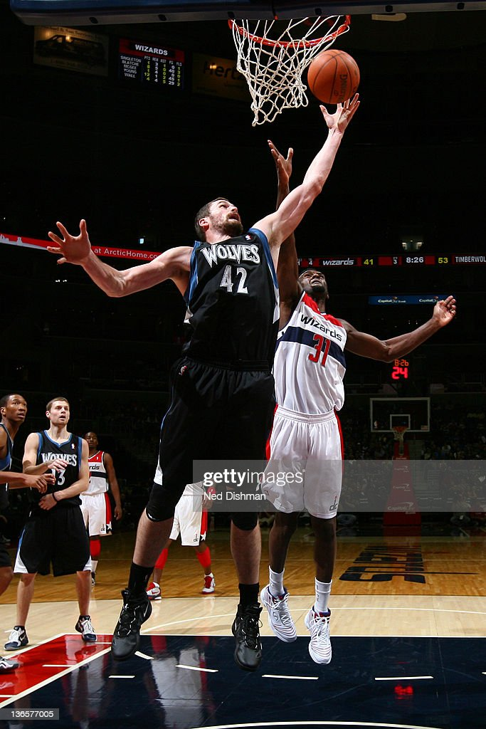 <a gi-track='captionPersonalityLinkClicked' href=/galleries/search?phrase=Kevin+Love&family=editorial&specificpeople=4212726 ng-click='$event.stopPropagation()'>Kevin Love</a> #42 of the Minnesota Timberwolves rebounds against Chris Singleton #31 of the Washington Wizards during the game at the Verizon Center on January 8, 2012 in Washington, DC.