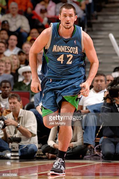 Kevin Love of the Minnesota Timberwolves runs upcourt during the preseason game against the Chicago Bulls at the United Center on October 14 2008 in...