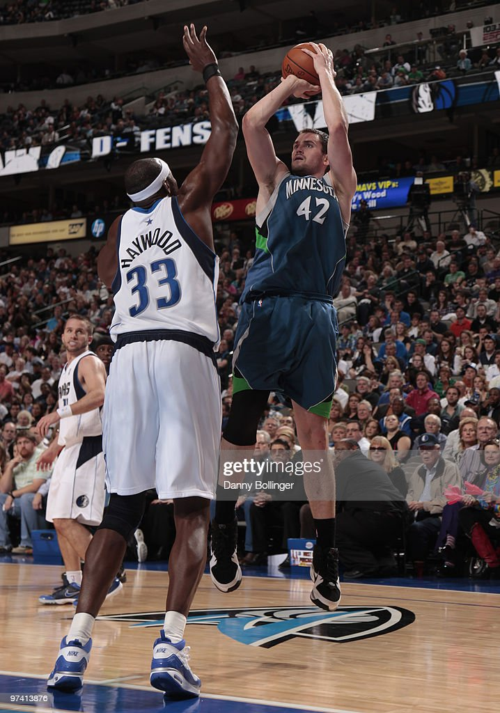 Kevin Love #42 of the Minnesota Timberwolves shoots a jumper against Brendan Haywood #33 of the Dallas Mavericks during a game at the American Airlines Center on March 3, 2010 in Dallas, Texas.