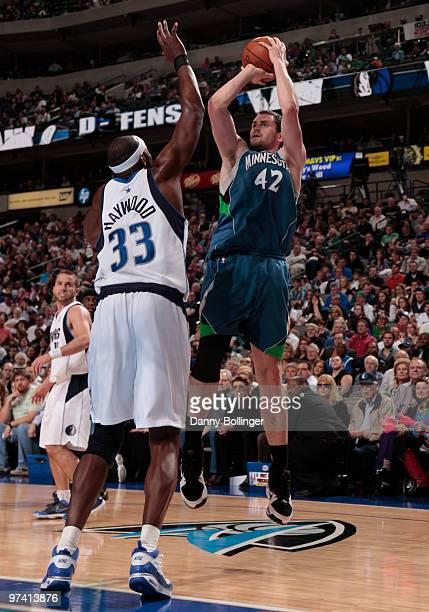 Kevin Love of the Minnesota Timberwolves shoots a jumper against Brendan Haywood of the Dallas Mavericks during a game at the American Airlines...