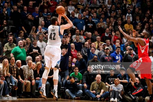 Kevin Love of the Minnesota Timberwolves shoots a threepointer against James Harden of the Houston Rockets on December 26 2012 at Target Center in...