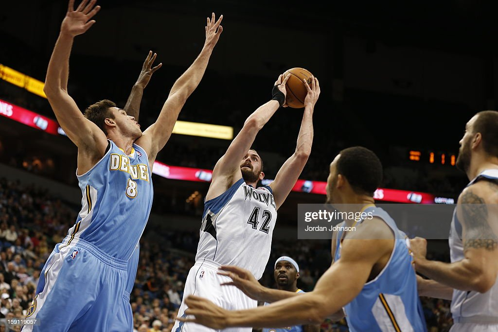 Kevin Love #42 of the Minnesota Timberwolves shoots against Danilo Gallinari #8 of the Denver Nuggets on November 21, 2012 at Target Center in Minneapolis, Minnesota.