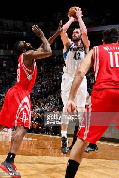 Kevin Love of the Minnesota Timberwolves shoots against James Harden of the Houston Rockets on December 26 2012 at Target Center in Minneapolis...