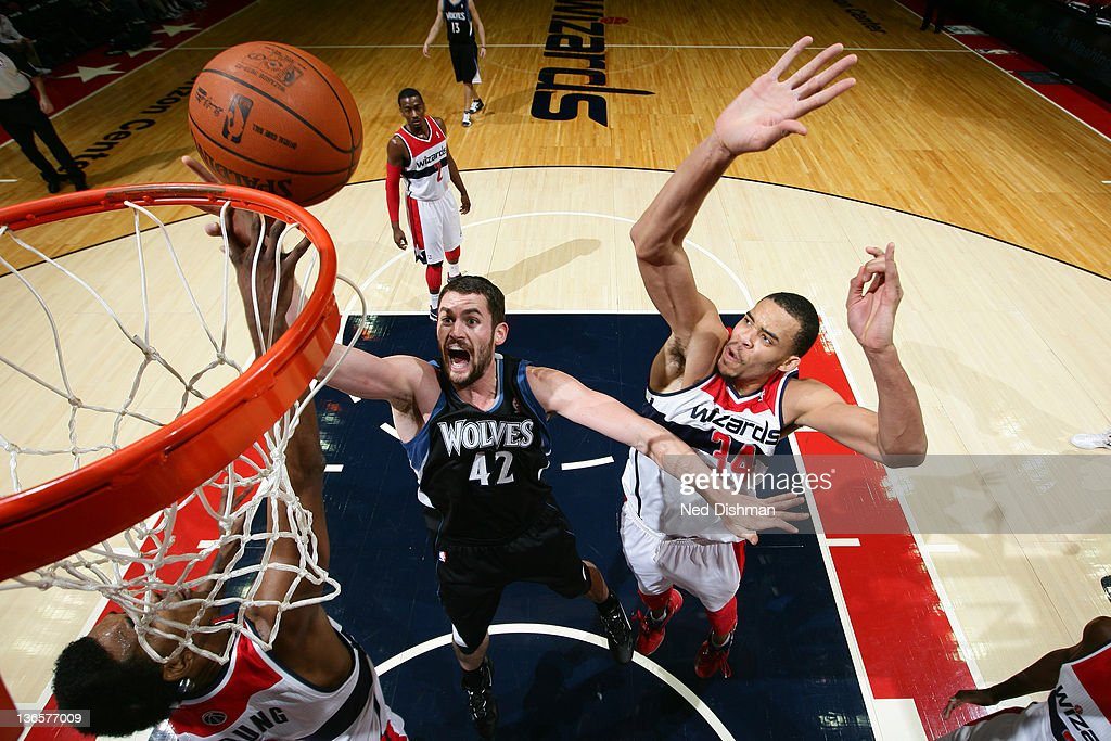 <a gi-track='captionPersonalityLinkClicked' href=/galleries/search?phrase=Kevin+Love&family=editorial&specificpeople=4212726 ng-click='$event.stopPropagation()'>Kevin Love</a> #42 of the Minnesota Timberwolves shoots against JaVale McGee #34 of the Washington Wizards during the game at the Verizon Center on January 8, 2012 in Washington, DC.