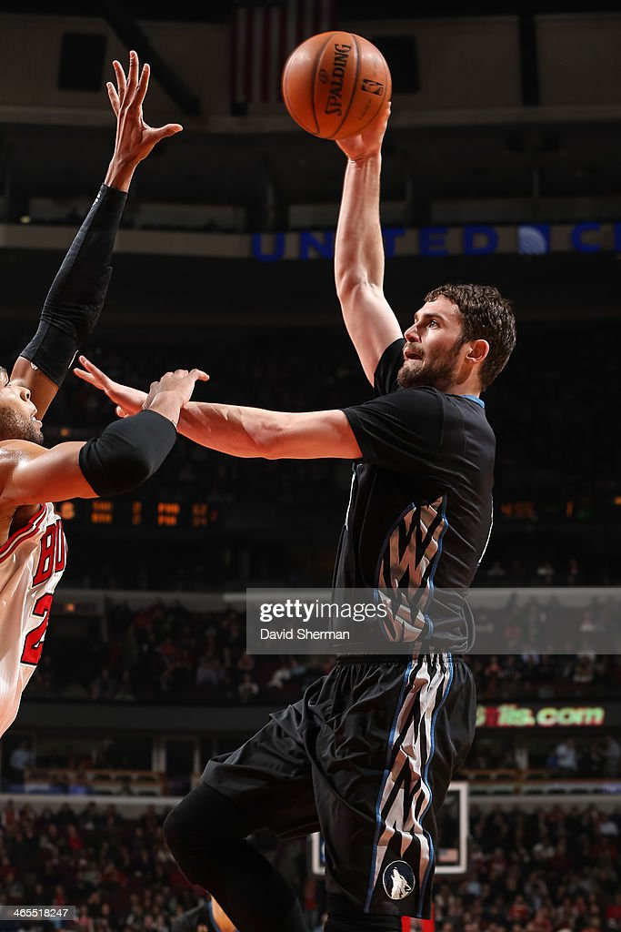 Kevin Love #42 of the Minnesota Timberwolves shoots against the Chicago Bulls on January 27, 2014 at the United Center in Chicago, Illinois.
