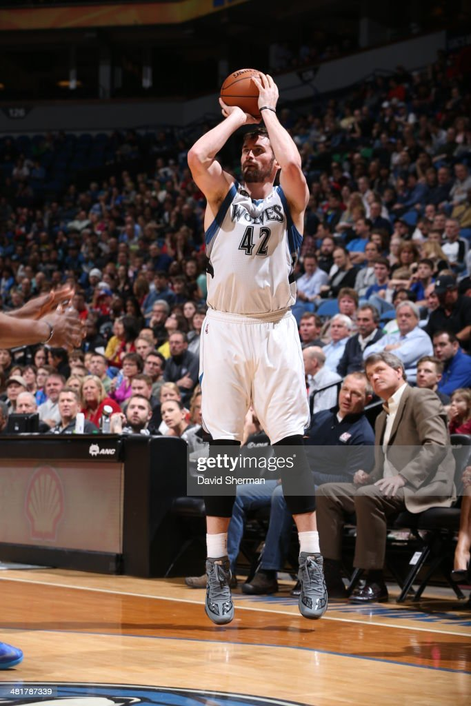 Kevin Love #42 of the Minnesota Timberwolves shoots against the Los Angeles Clippers on March 31, 2014 at Target Center in Minneapolis, Minnesota.