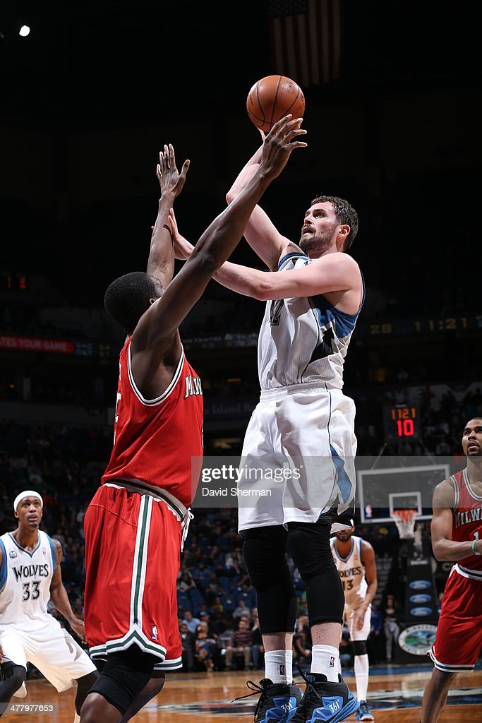 Kevin Love #42 of the Minnesota Timberwolves shoots against the Milwaukee Bucks on March 11, 2014 at Target Center in Minneapolis, Minnesota.