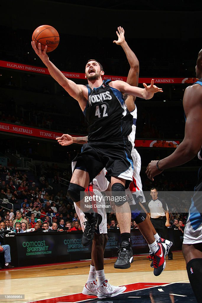 <a gi-track='captionPersonalityLinkClicked' href=/galleries/search?phrase=Kevin+Love&family=editorial&specificpeople=4212726 ng-click='$event.stopPropagation()'>Kevin Love</a> #42 of the Minnesota Timberwolves shoots against the Washington Wizards during the game at the Verizon Center on January 8, 2012 in Washington, DC.