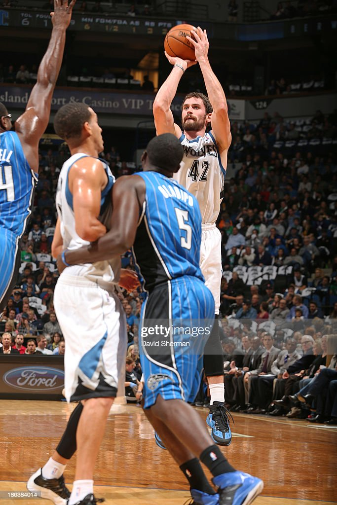 Kevin Love #42 of the Minnesota Timberwolves shoots the ball against the Orlando Magic during the season and home opening game on October 30, 2013 at Target Center in Minneapolis, Minnesota.