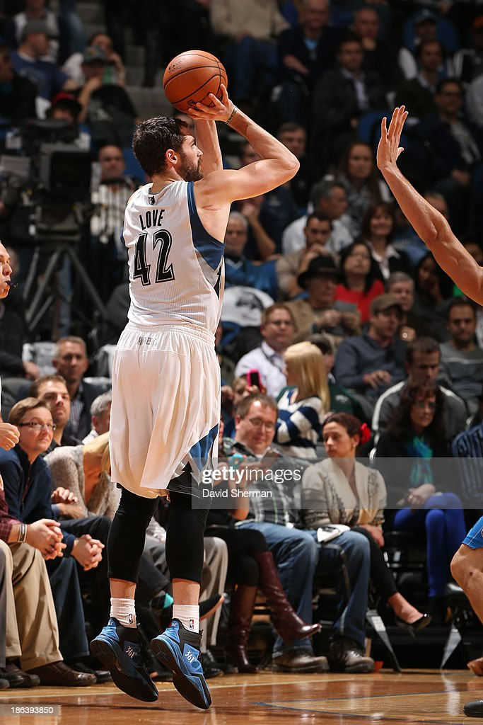 <a gi-track='captionPersonalityLinkClicked' href=/galleries/search?phrase=Kevin+Love&family=editorial&specificpeople=4212726 ng-click='$event.stopPropagation()'>Kevin Love</a> #42 of the Minnesota Timberwolves shoots the ball against the Orlando Magic during the season and home opening game on October 30, 2013 at Target Center in Minneapolis, Minnesota.